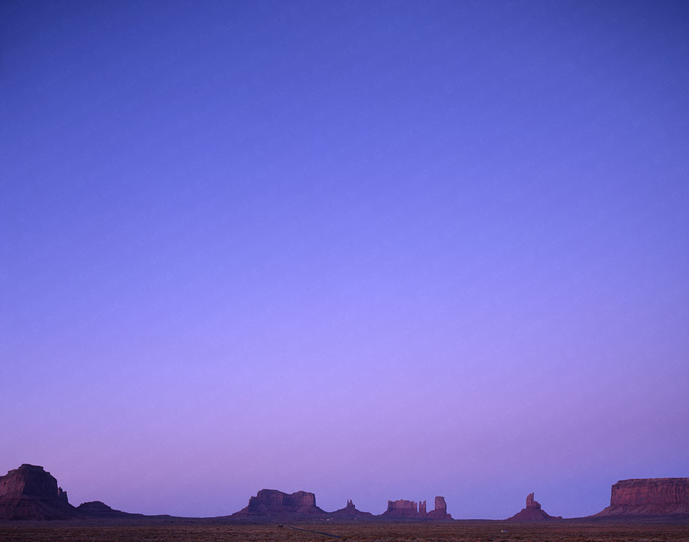 Monuments at Dusk, Monument Valley, Utah, USA. Fine Art Natural Landscape color Photography by Jesus Coll