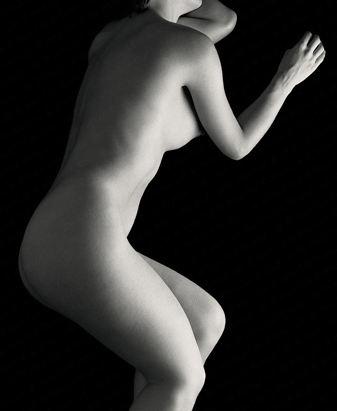 Nude profile on Black. Fine Art Nude Photography by Jesus Coll