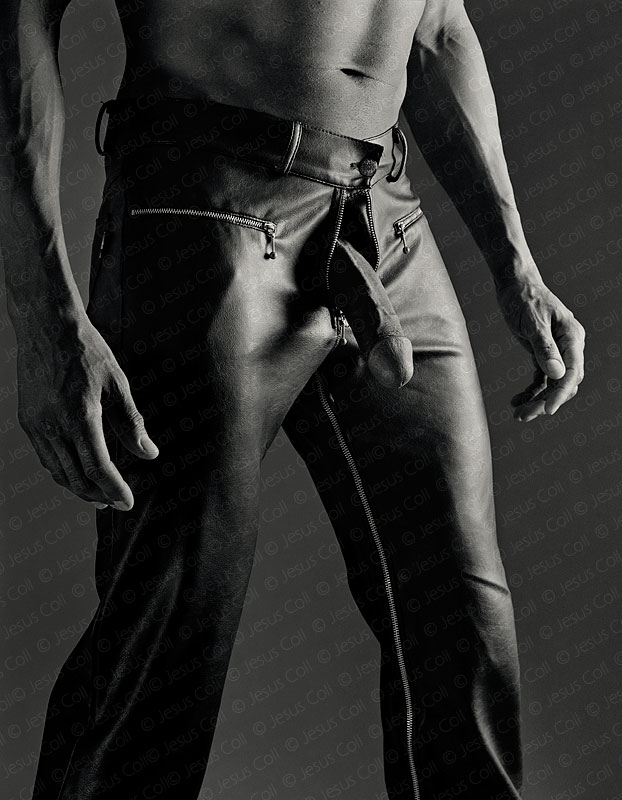 Natural Leather. Black man dressed in black leather trousers showing his prick. Erotic FineArt Phtoography by Jesus Coll