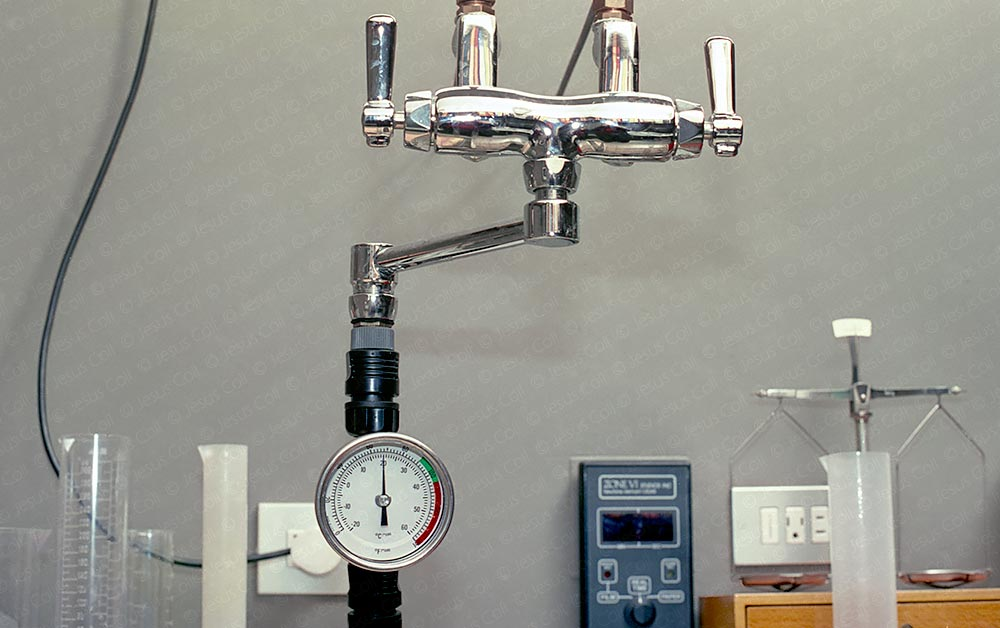 Analog Photographic Darkroom. Thermometer on the general faucet to control water temperature while miximg chemicals. © Jesus Coll